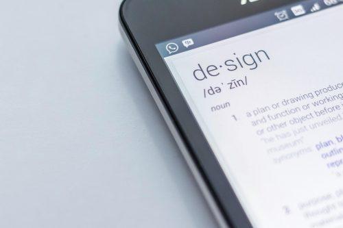 un écran de smartphone affichant la définition du mot design